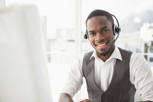 Happy-businessman-with-headset-interacting-in-his-office