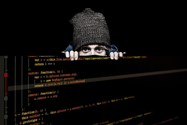 hacker overlooking sensitive data